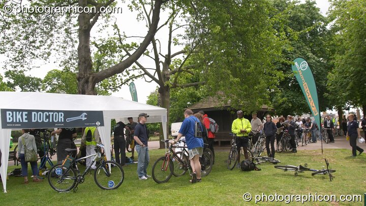 People queuing for the popular Bike Doctor free bicycle inspection service at the London Green Lifestyle Show 2005. Great Britain. © 2005 Photographicon