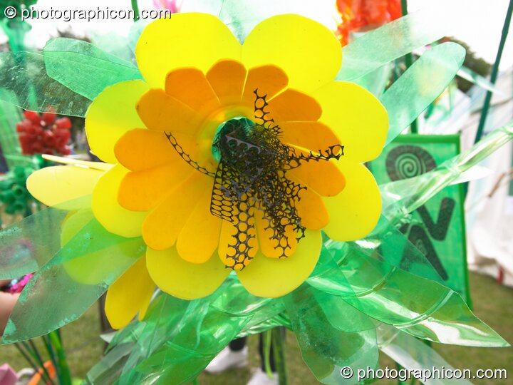 A flower made from reclaimed scrap plastic at the London Green Lifestyle Show 2005. Great Britain. © 2005 Photographicon
