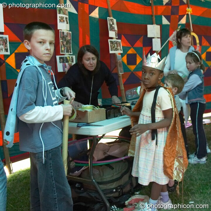 Two boys prepare their fancy dress in the Save The World Club carnival workshop at the London Green Lifestyle Show 2005. Great Britain. © 2005 Photographicon