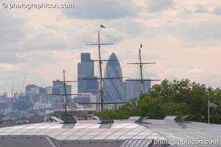 View of the 'Gherkin' and Cutty Sark over Greenwich roofs at the London Green Lifestyle Show 2005. Great Britain. © 2005 Photographicon
