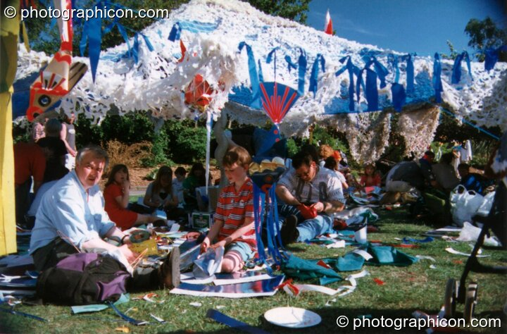 People chilling on shaded grass at Kingston Green Fair 1997. Kingston upon Thames, Great Britain. © 1997 Photographicon