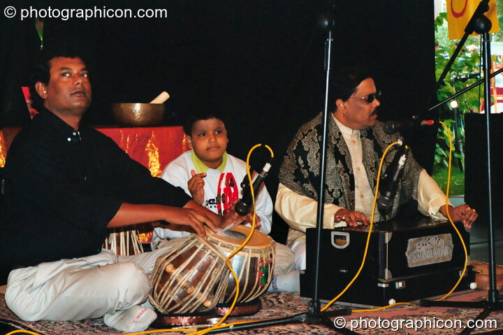 Muscians from Bangladesh play spiritual sounds at Kingston Green Fair 2002. Kingston upon Thames, Great Britain. © 2002 Photographicon