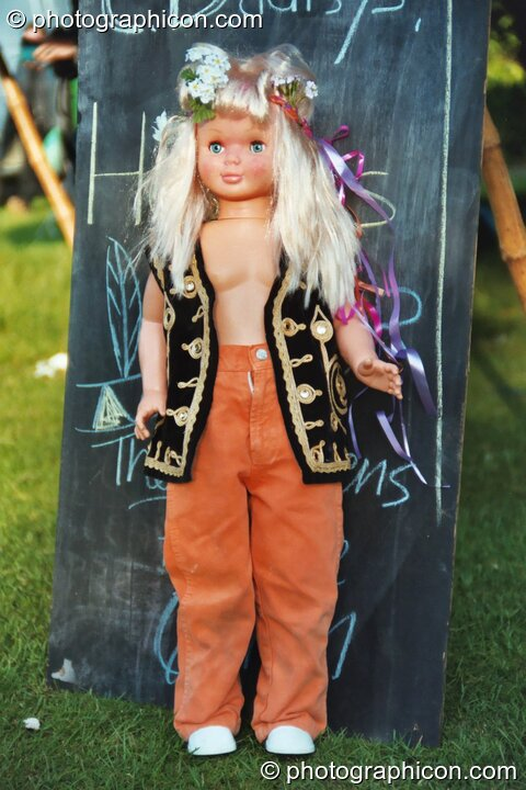 A Barbie doll dressed in hippie clothes at Kingston Green Fair 2002. Kingston upon Thames, Great Britain. © 2002 Photographicon