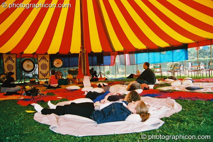 Peaceful meditation in the Healing Area at Kingston Green Fair 2003. Kingston upon Thames, Great Britain. © 2003 Photographicon