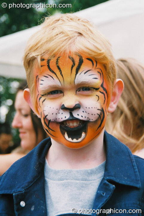 Boy with his face professionally painted as a lion at Kingston Green Fair 2003. Kingston upon Thames, Great Britain. © 2003 Photographicon
