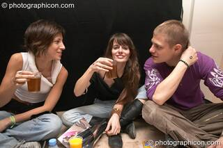 Three friends at Dr Love's Psychoactive Explosion. London, Great Britain. © 2004 Photographicon