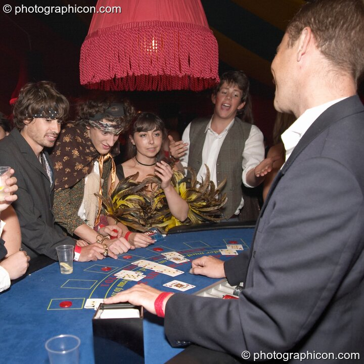Man wins his hand on the casino card table at the Lost Vagueness Summer Party 2004. Lewes, Great Britain. © 2004 Photographicon