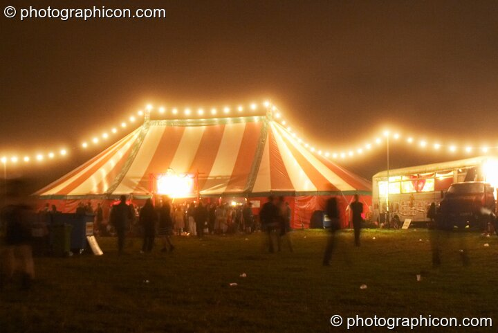 Long strings of fairy lights strung across the marquees glow in the night mist at the Lost Vagueness Summer Party 2004. Lewes, Great Britain. © 2004 Photographicon
