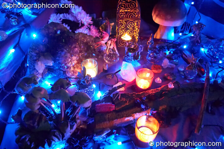 A wonderland of crystals and model fairies lit by small blue lights - decor part of the Omniscience Tea Stall at Chrysalid. London, Great Britain. © 2006 Photographicon