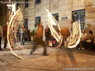 A fire-sabre performance by Jedi Jugglers outside the Kalahari party. London, Great Britain. © 2006 Photographicon