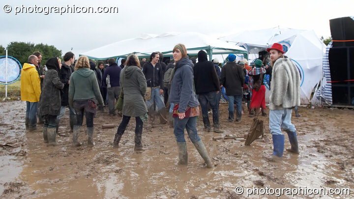 Dancers in the mud outside the Little Green Planet Stage  at the Echo Festival. Overton, Great Britain. © 2007 Photographicon