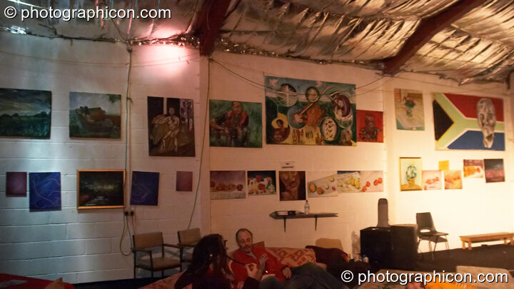 Paintings hanging on the wall in the chillout at Saharawi, The Synergy Centre. London, Great Britain. © 2007 Photographicon