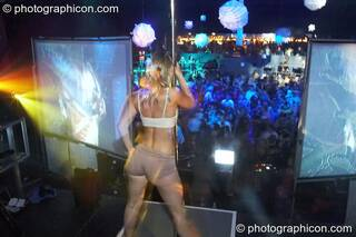 Fluorotrash Ingrid pole dances on the main stage lit by projection from Coldcut, with music by Psymmetrix and decor by Fluffy Mafia at the Pukka / Interpole / Mindscapes Halloween party. London, Great Britain. © 2007 Photographicon