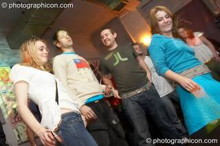 Mary, James, Dave, and Louise dance at Future Music Vol. 1. London, Great Britain. © 2007 Photographicon