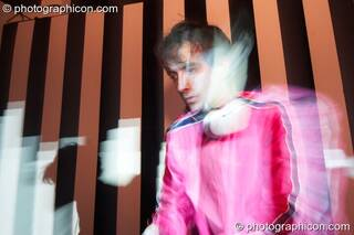 Liquid James (Liquid Records, UK) DJ's in front of a video installation by Pixel Addicts featuring bar screen and VJ projections at Dave Green's birthday party. London, Great Britain. © 2007 Photographicon