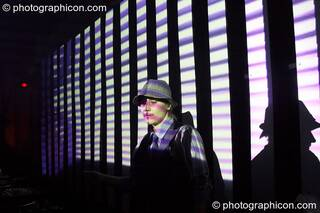 Louise Gandolfi (Chillosophy / IDSpiral, UK) DJ's in front of a video installation by Pixel Addicts featuring bar screen and VJ projections at Dave Green's birthday party. London, Great Britain. © 2007 Photographicon