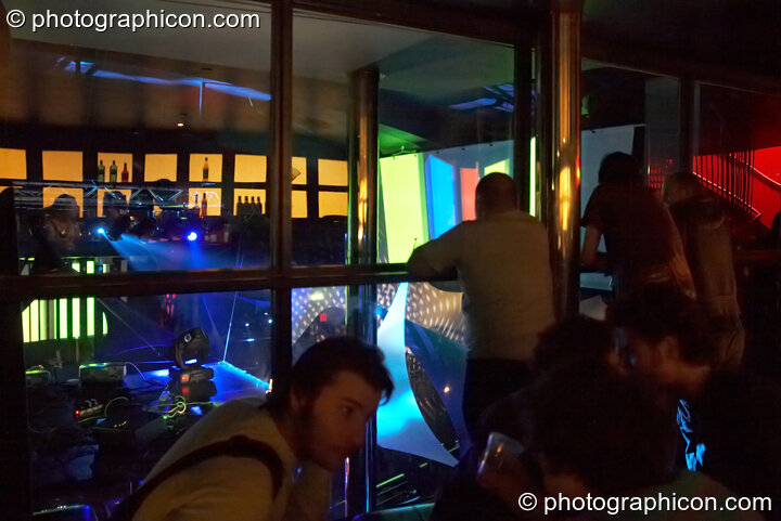 Looking out of the glass bar reveals a visual show in the main Future Funk Room at Future Music. London, Great Britain. © 2008 Photographicon