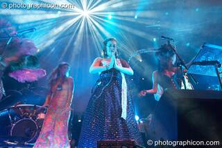 Abigail Gorton performs a prayer dance flanked by Michele Adamson, Serena, and Simon Posford at Shpongle Live in Concert. London, Great Britain. © 2008 Photographicon