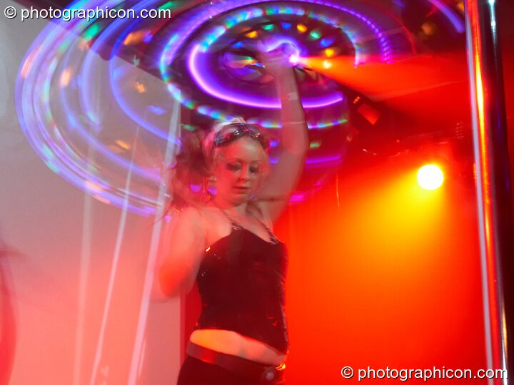 A woman spins an illuminated hoopa hoop at Electric Circus / Circus2Gaza. London, Great Britain. © 2009 Photographicon