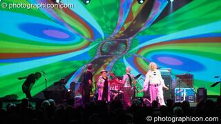 Miquette Giraudy, Steve Hillage, Gilli Smyth, Chris Taylor, Mike Howlett, and Daevid Allen of Planet Gong perform at the Kentish Town Forum with visual projections by ColourSound. London, Great Britain. © 2009 Photographicon