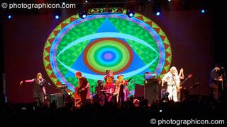 Miquette Giraudy, Steve Hillage, Chris Taylor, Gilli Smyth, Daevid Allen, Mike Howlett, and Theo Travis of Planet Gong perform at the Kentish Town Forum with visual projections by ColourSound. London, Great Britain. © 2009 Photographicon