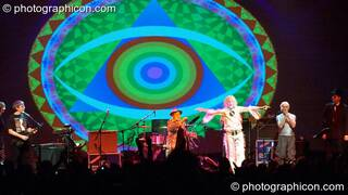 Miquette Giraudy, Steve Hillage, Gilli Smyth, Chris Taylor, Daevid Allen, Mike Howlett, and Theo Travis of Planet Gong perform at the Kentish Town Forum with visual projections by ColourSound. London, Great Britain. © 2009 Photographicon