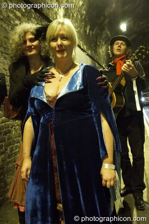 Michelle Watson and a sister Goose Girl are serenaded by Nigel of Bermondsey in the Weston Street tunnel at The Halloween of the Cross Bones XIII. London, Great Britain. © 2010 Photographicon