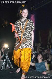 Woman stands on the catwalk modelling for an ethical fashion show at The Synergy Project. London, Great Britain. © 2005 Photographicon