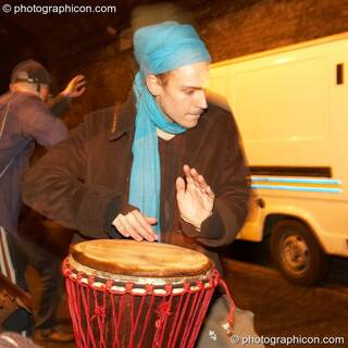 Anthony drums during a Spirit Jamming session in the road tunnel outside The Synergy Project. London, Great Britain. © 2006 Photographicon