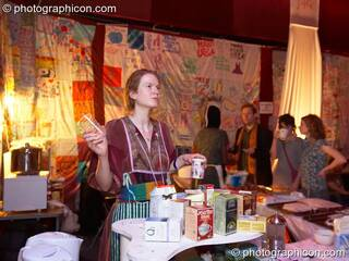 A woman serves tea at the cafe in the Speak space at The Synergy Project. London, Great Britain. © 2006 Photographicon