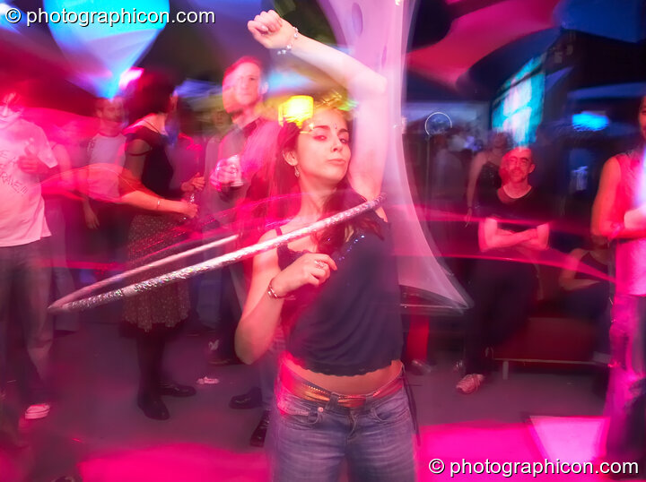 Natalie dances with a hula hoop at The Synergy Project. London, Great Britain. © 2006 Photographicon