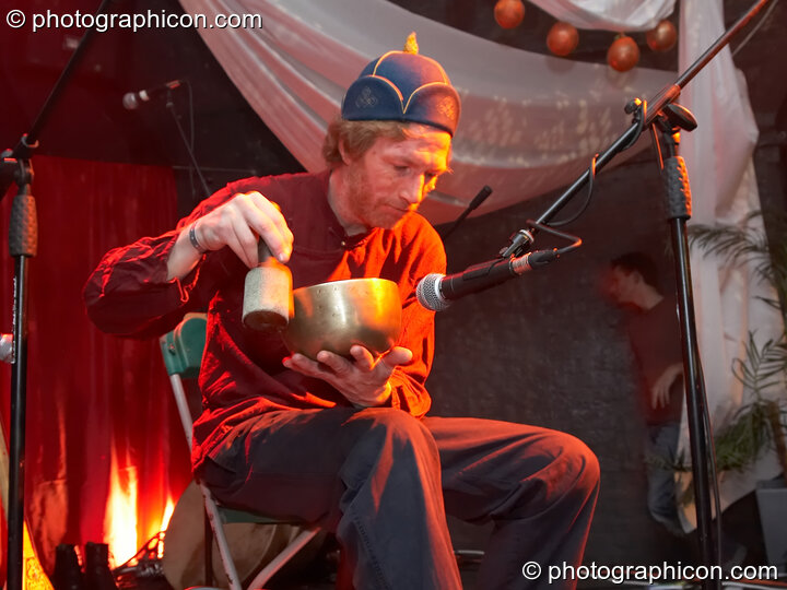 Michael Ormiston performs with a sound bowl on the Silk Road Arts stage at The Synergy Project. London, Great Britain. © 2007 Photographicon
