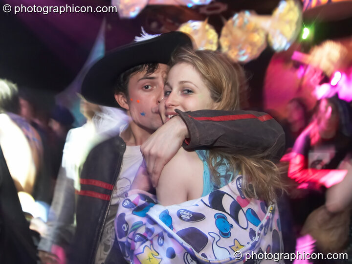 A man and woman kiss on the dancefloor in the Kundalini room at The Synergy Project. London, Great Britain. © 2007 Photographicon