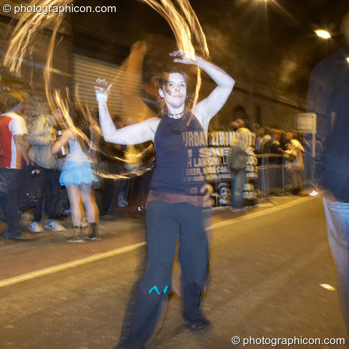 A woman fire-twirls in the road tunnel outside The Synergy Project. London, Great Britain. © 2007 Photographicon