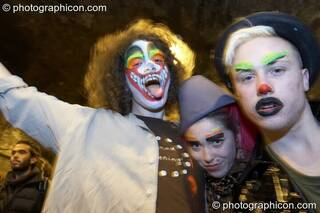 Revellers with painted faces queue in the tunnel outside at The Synergy Project. London, Great Britain. © 2007 Photographicon