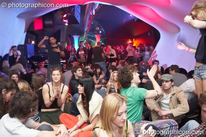 People chill inside the Folktronica room decor tunnel at The Synergy Project. London, Great Britain. © 2008 Photographicon