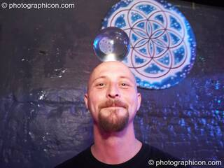 A man balances a transparent jugglin ball on his head in the Liquid Records room at Luminopolis (formerly The Synergy Project). London, Great Britain. © 2008 Photographicon