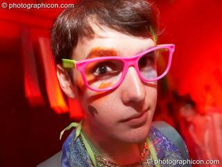 A man wearing wonky pink glasses dances in the Square Roots space at The Synergy Project. London, Great Britain. © 2007 Photographicon