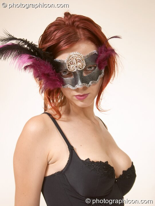 Mistress Sirena (aka Ingrid Pianet) models an erotic costume and feather mask. Surbiton, Great Britain. © 2004 Photographicon
