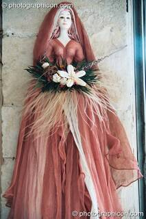 Decorative doll on a wall in Rethymno. Greece. © 2002 Photographicon