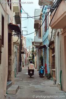 Man on scooter vanishes down a side street in Rethymno. Greece. © 2002 Photographicon