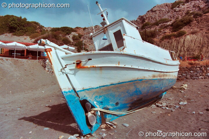 An abandoned boat on the beach at Agios Pavlos. Greece. © 2002 Photographicon