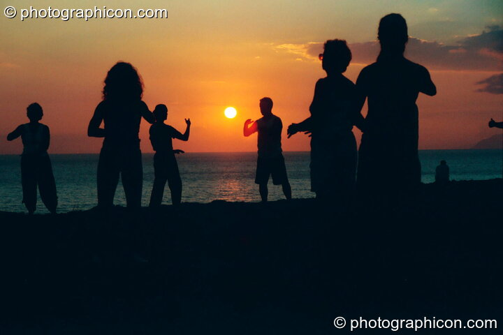 A group of people practising Tai Chi as the sun sets on a cliff at Agios Pavlos. Greece. © 2002 Photographicon