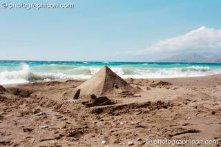 The pyramid that Dominic built on the beach at Agios Pavlos. Greece. © 2002 Photographicon