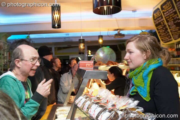 Staff serve behind the cafe counter at the launch party for the inSpiral Lounge organic cafe and multimedia venue. London, Great Britain. © 2007 Photographicon