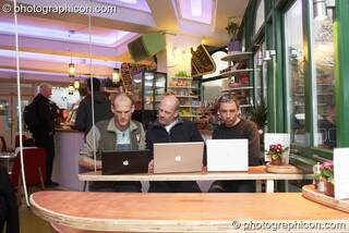 Three men work on their laptop computers in the inSpiral Lounge organic cafe and multimedia venue. London, United Kingdom. © 2008 Photographicon