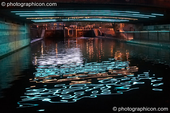 Lights reflect in the water of Regent's Canal underneath Camden Lock bridge (South East side next to the inSpiral Lounge). London, United Kingdom. © 2008 Photographicon