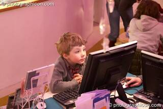 A young boy plays on an Internet terminal in the inSpiral Lounge organic cafe and multimedia venue. London, Great Britain. © 2008 Photographicon