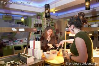 A woman buys food at the counter in the inSpiral Lounge organic cafe and multimedia venue. London, Great Britain. © 2008 Photographicon