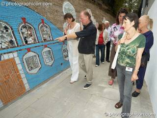 People admire Save The World Club's Hundertwasser mosaic. Kingston Upon Thames, Great Britain. © 2005 Photographicon